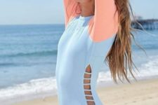 04 a pastel color block one piece swimsuit with long sleeves, a high neckline and side cutouts