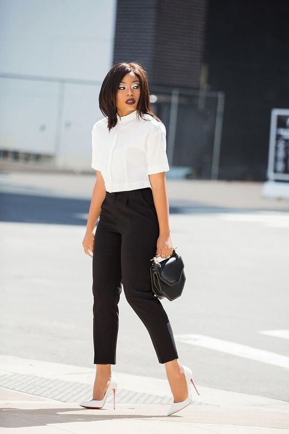 a white button down with short sleeves, black pants, white heels and a small black bag is a modern take on classics