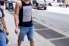 04 denim shorts, a black sleeveless top with prints, grey strappy sandals for a hot day