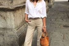 04 tan cropped pants, a white button down, brown slippers, a brown bucket bag for a dauly outfit