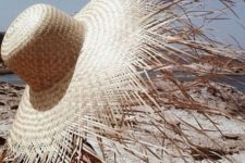 05 a heavily fringed brim hat is a trendy statement idea to rock during your vacation or summer