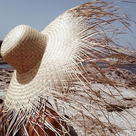 a heavily fringed brim hat is a trendy statement idea to rock during your vacation or summer