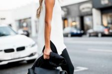 05 a long sleeveless white top, black pants, black shoes and a black tote for more conservative ladies