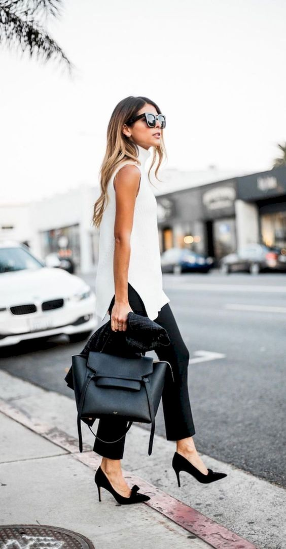 a long sleeveless white top, black pants, black shoes and a black tote for more conservative ladies