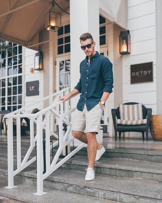 a navy chambray shirt, neutral shorts and white sneakers are all you need to feel cool in summer