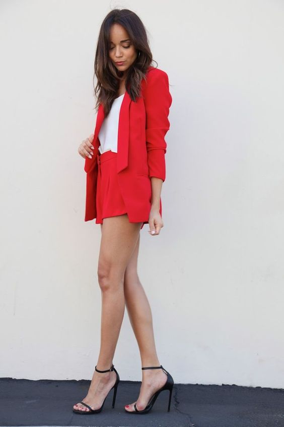 a red short suit, a white top, black heels are all you need for an ultimate professional look
