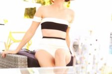 05 a retro-inspired bikini with an off the shoulder striped top and a high waisted bottom is refined