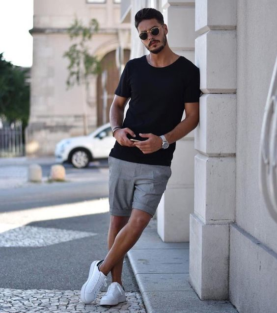 a black tee, grey shorts, white sneakers for a relaxed and casual summer outfit