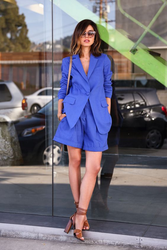 a bold blue oversized short suit, a brown bag and brown block heels for a catchy summer work look