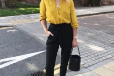 06 a chic work look with a mustard button down, black pants, mustard bow slippers and a black bucket bag