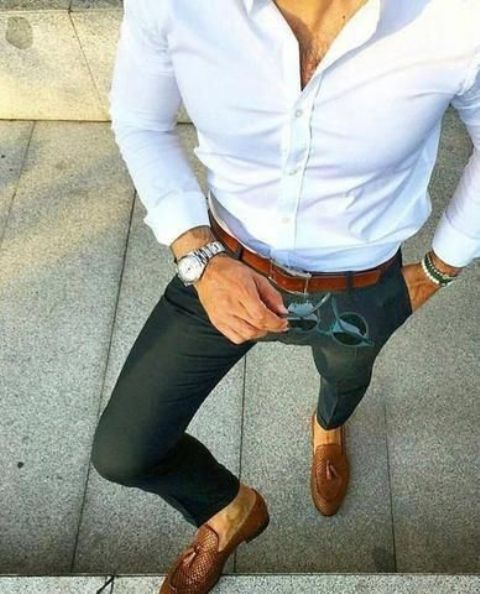 a comfy work look with a white button down, dark green pants, brown loafers and a matching belt
