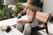 06 a fringe brim straw ha and a striped linen jumpsuit are all you need for an effortlessly chic look