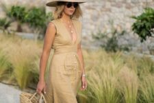 06 a nude linen midi dress with a plunging neckline, espadrilles, a straw hat and a straw bag