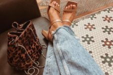 06 light blue distressed jeans paired with tan strappy mules with square toes are a cool combo