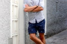 07 a bright and trendy look with a blue button down, navy printed shorts, bright blue loafers