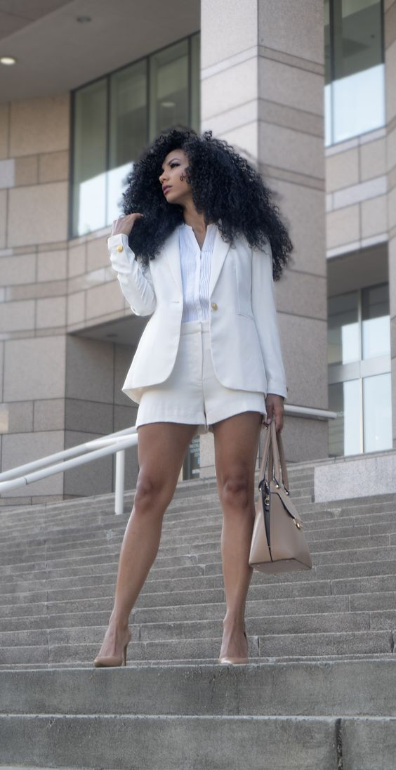 a creamy short suit, a white button down, nude heels and a matchign bag for work in summer