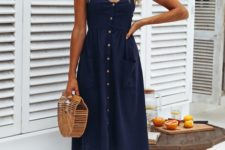 07 a navy linen midi dress with a row of brown buttons, brown lace up sandals and a wooden bag