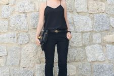07 a total black look with a spaghetti strap top, black cropped pants, black slippers and a black bag