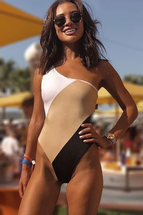 a chic and trendy one shoulder one piece swimsuit with color blocking   white, beige and black