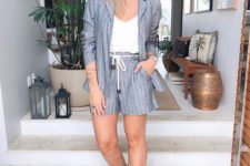 08 a striped grey suit, a white top, white sneakers for a csual summer business look