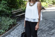 08 a white sleeveless layered top, black pants, black and brown shoes and a black tote