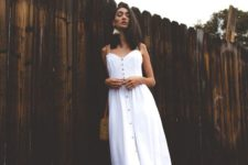 09 a white linen midi dress with straps and buttons, brown slippers and a brown bag