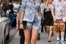 10 a blue floral print short suit, a black top, a statement necklace and black block heels for a party