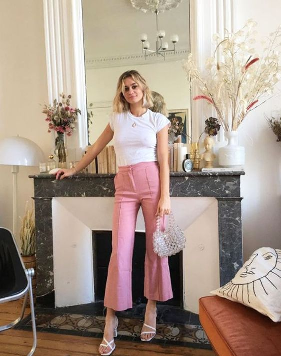 a chic look with a white tee, pink fit and flare pants, white square toe shoes and a shiny bag