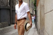 10 a comfy holiday look with a white button down, yellow pants, brown loafers and a matching belt plus a hat