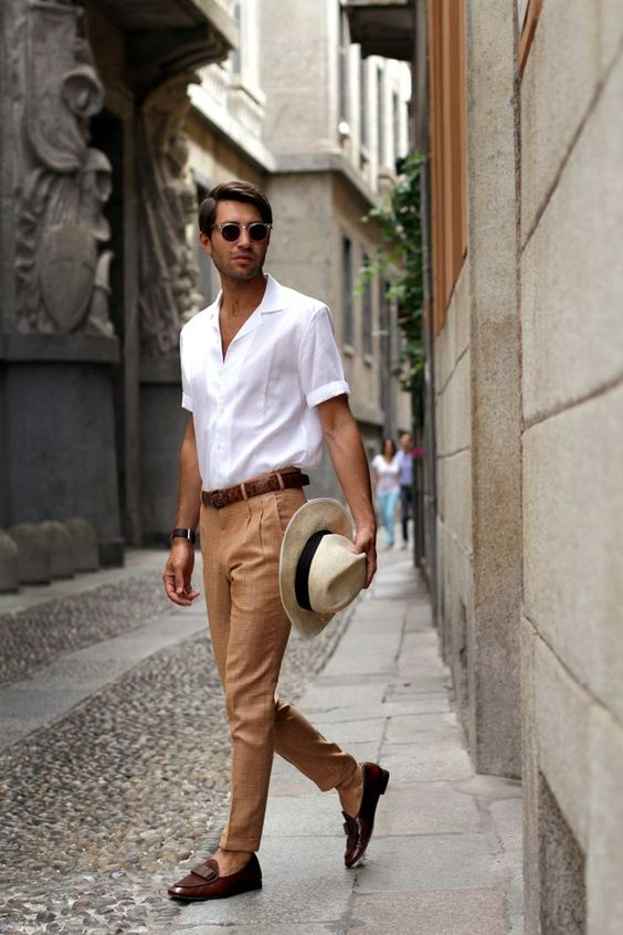 a comfy holiday look with a white button down, yellow pants, brown loafers and a matching belt plus a hat