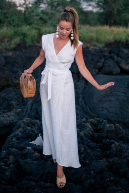 a white linen wrap midi dress, statement earrings, nude mules and a wooden bag for a cute feel