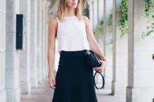 11 a black midi, a white sleeveless top, black sandlas and a black clutch are a perfect combo