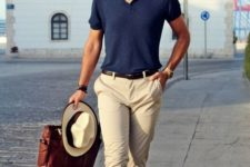 11 a navy t-shirt, tan pants, brown loafers, a matching belt, a hat for a hot summer day