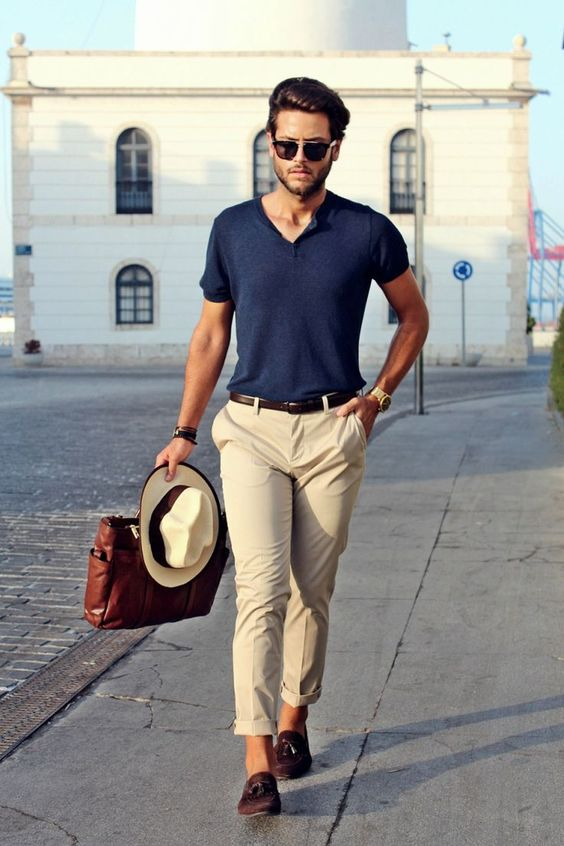 a navy t shirt, tan pants, brown loafers, a matching belt, a hat for a hot summer day