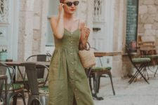 11 an olive green spaghetti midi dress with a row of buttons, brown slippers, a straw bucket bag