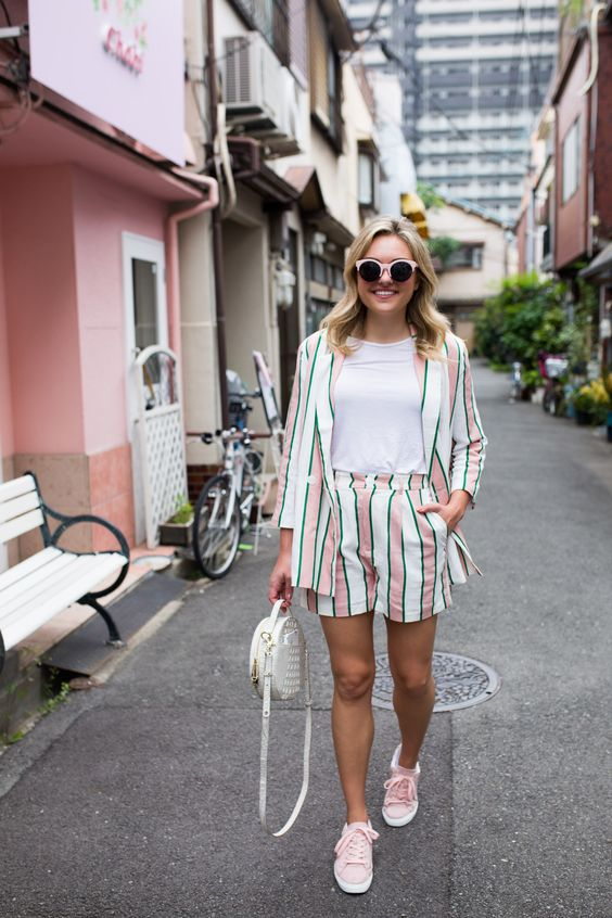 a fun and colorful stripe short suit, a white tee, pink sneakers and a white round bag for summer