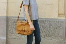 12 a grey tee, navy cropped skinnies, a tan bag and white slingbacks with square toes