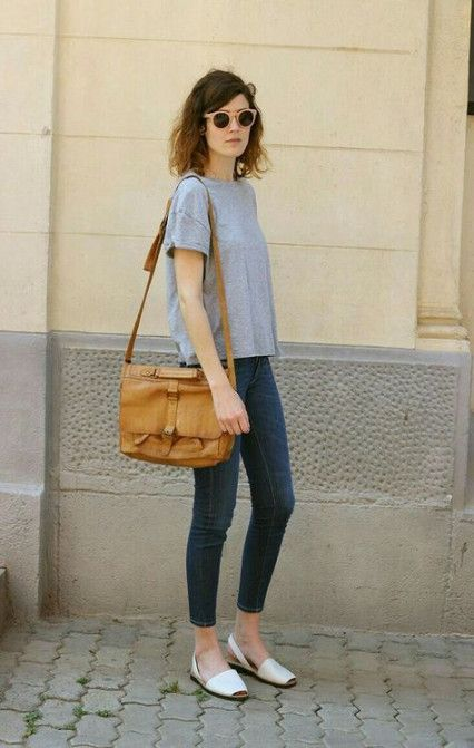 a grey tee, navy cropped skinnies, a tan bag and white slingbacks with square toes
