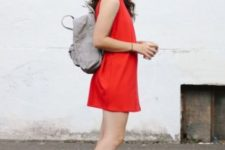 12 a hot red mini dress, white dad sandals, a grey backpack for a comfy modern summer look