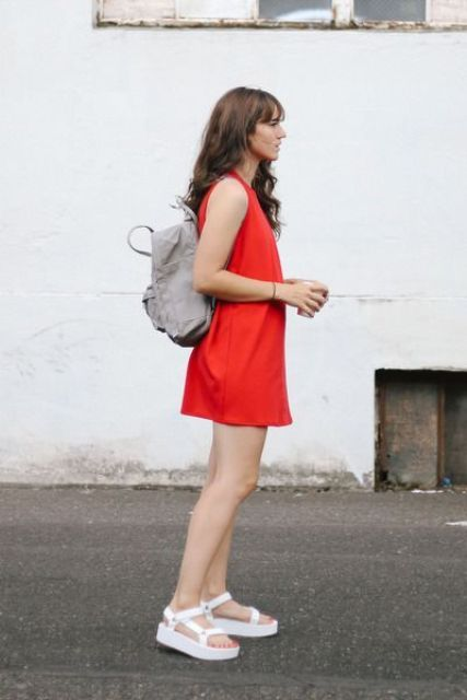 a hot red mini dress, white dad sandals, a grey backpack for a comfy modern summer look