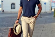 12 a navy tee, tan pants, brown loafers, a matching belt and bag plus a neutral hat for a holiday