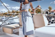 12 a powder blue linen midi dress with buttons and a square cut is a super trendy option