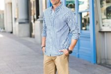 12 a preppy summer look with a white tee, a blue checked shirt, tan shorts and navy loafers