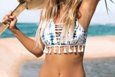 13 a blue and white tie dye bikini with fringe on the top and some straps feels modern and boho