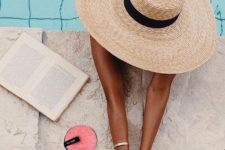 13 a comfortable straw hat with a black ribbon is a timeless summer or vacation accessory to rock