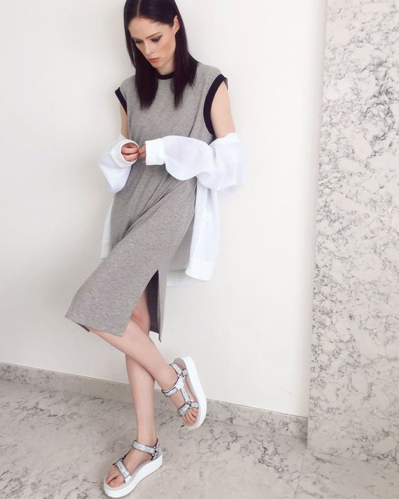 a modern grey cap sleeve midi dress with slits, a white button down, white dad sandals