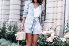 13 a powder blue striped suit, a white top, neutral sneakers and a blush bag for a holiday or office