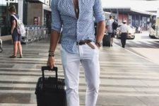 13 a relaxed holiday look with a blue printed shirt, white pants, dark loafers with embroidery