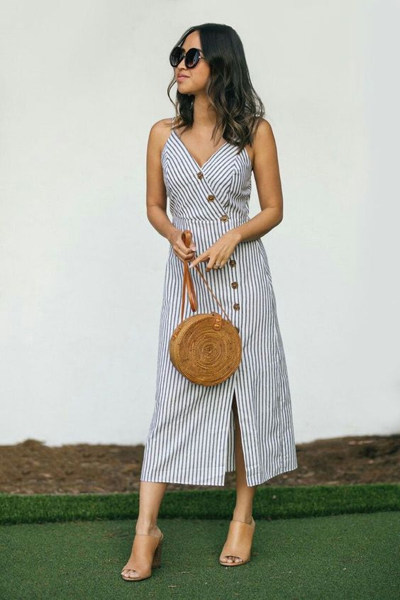 a trendy look with a striped linen midi dress with buttons, a brown bag and matching mules