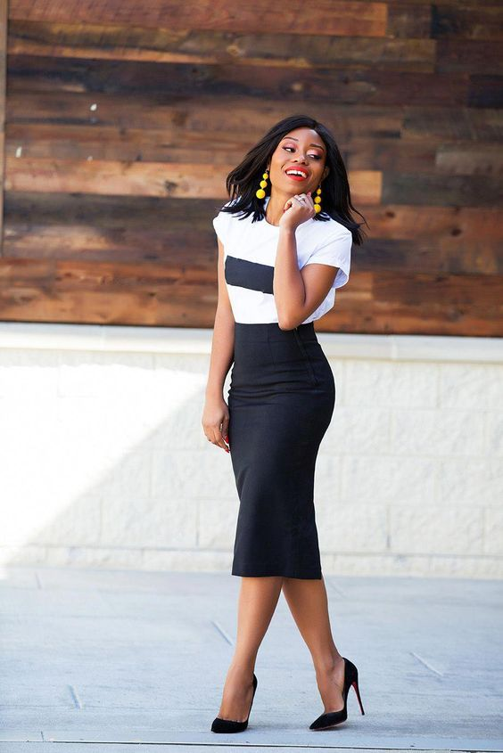 a casual summer work outfit with a black and white tee, a black pencil midi, black heels and statement earrings